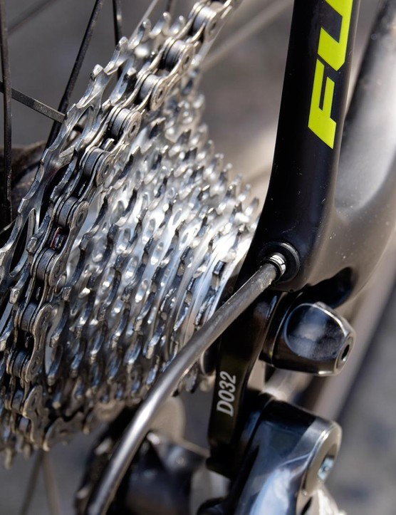 Cables are routed internally through the Fuji's carbon frame