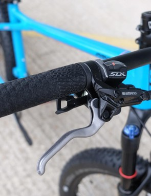 The Shimano SLX/XT transmission shifts through a Sunrace 11-42t cassette at the rear
