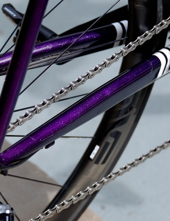 The frame blends from a vivid purple at the chainstays through to a dark blue at the head tube