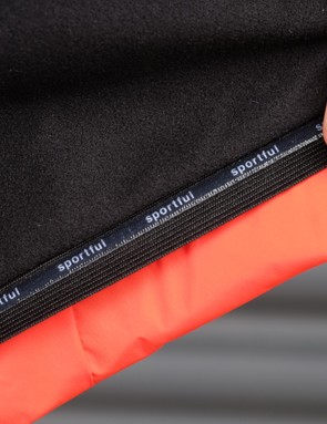 A silicone gripper runs around the waist of the jacket