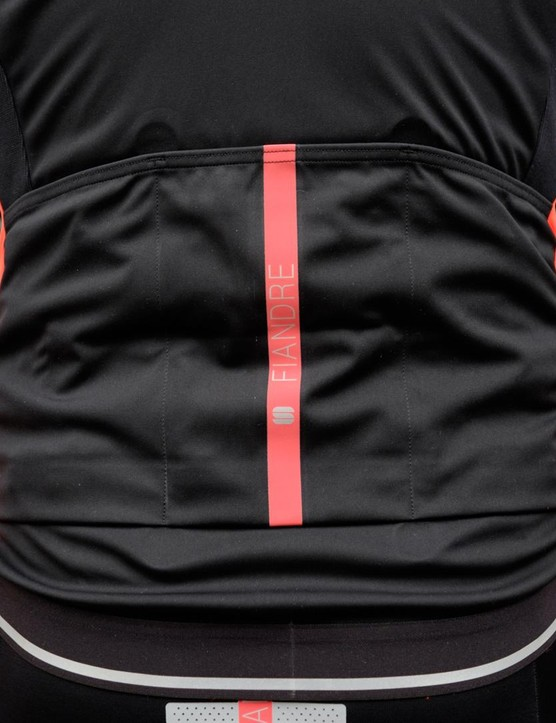 While the rear of the jacket is predominantly black, there are reflective accents around the hem and the Fiandre logo