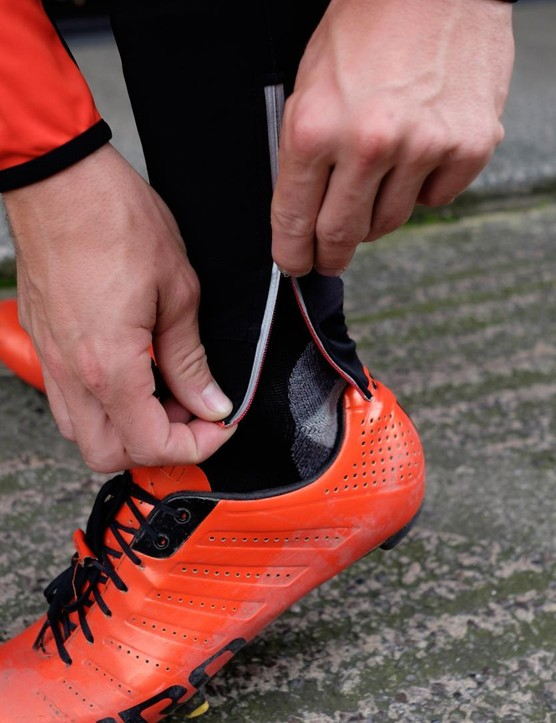 Ankle zips feature on the tights and ensure ease of removal after a wet, cold ride