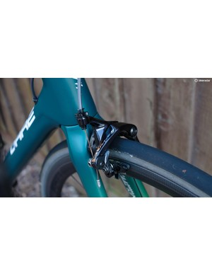 Dura-Ace rim brakes deliver an exceptionally light and well-modulated feel at the lever