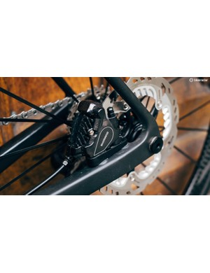 Flat Mount calipers tuck neatly within the rear triangle of the Ultimate