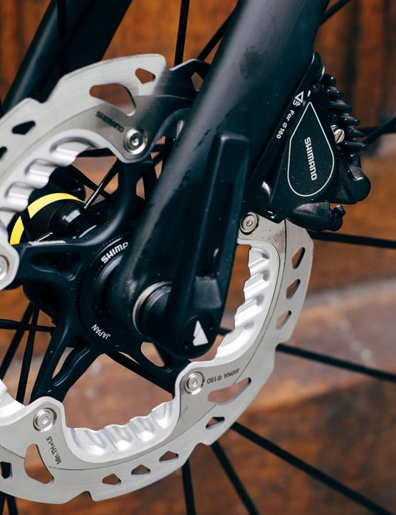 Shimano hydraulic disc brakes come with 160mm rotors, for those concerned about heat dissipation