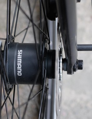 A Shimano dynamo hub at the front wheel feeds power directly to the Skyline's AXA front and rear lights