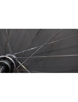 Notice how the spokes change profile after they cross