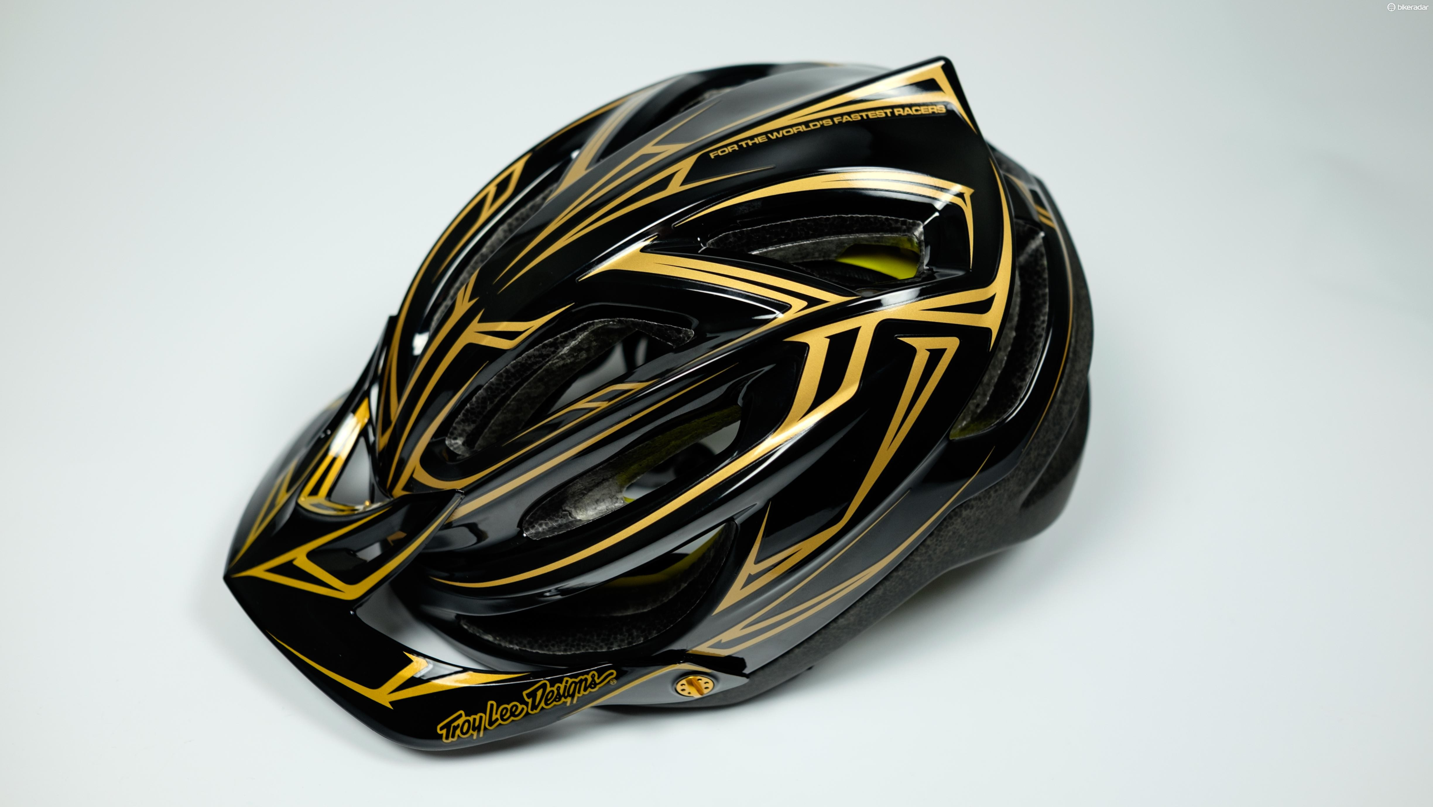 Troy Lee's A2 helmet looks particularly nice in this black/gold pinstripe colour scheme