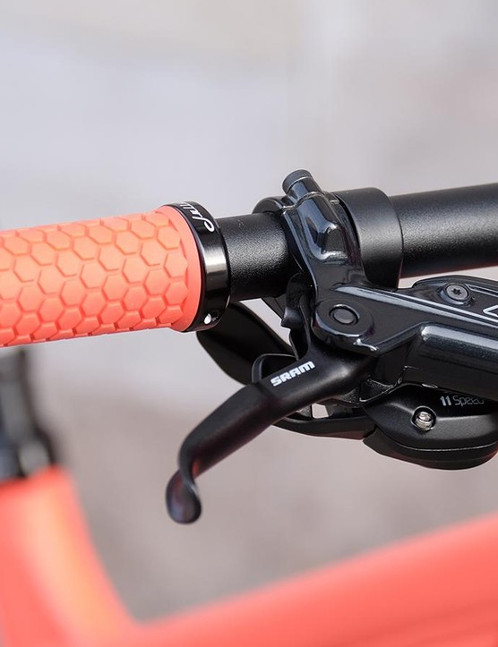 Coral-coloured Juliana grips are specced to match the bike