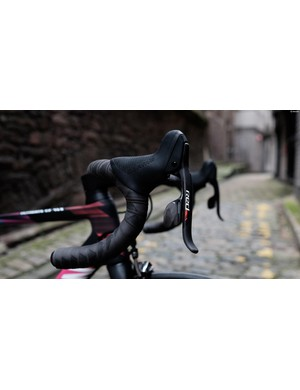 SRAM Red shifters provide upshifts and downshifts with the press of a single lever