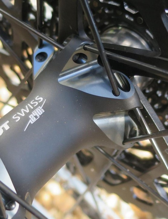 The rear hub shell has been redesigned with flange placement and spoke angle — DT Swiss claims a 15% improvement in side stiffness for the rear wheel