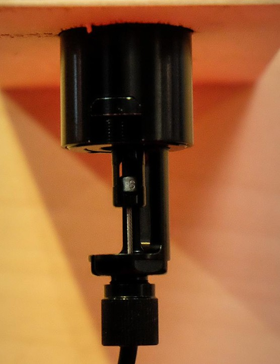 The fixed end of the cable is positioned at the base of the seatpost