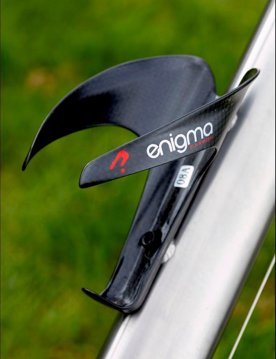 A carbon bottle cage with the Enigma marque