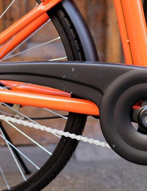 A pressed-steel chainguard protects the drivetrain
