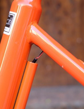 There is a vestigial tube on the back of the seat tube that would have been used to connect the wheel lock
