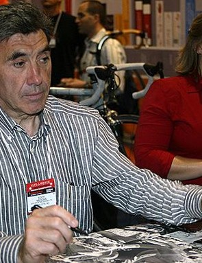 Eddy Merckx, signing posters at the 2005 Interbike Show.