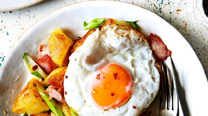 The textures in this dish are lovely: crisp potatoes, smooth rich egg yolk and the crunch of spring onions