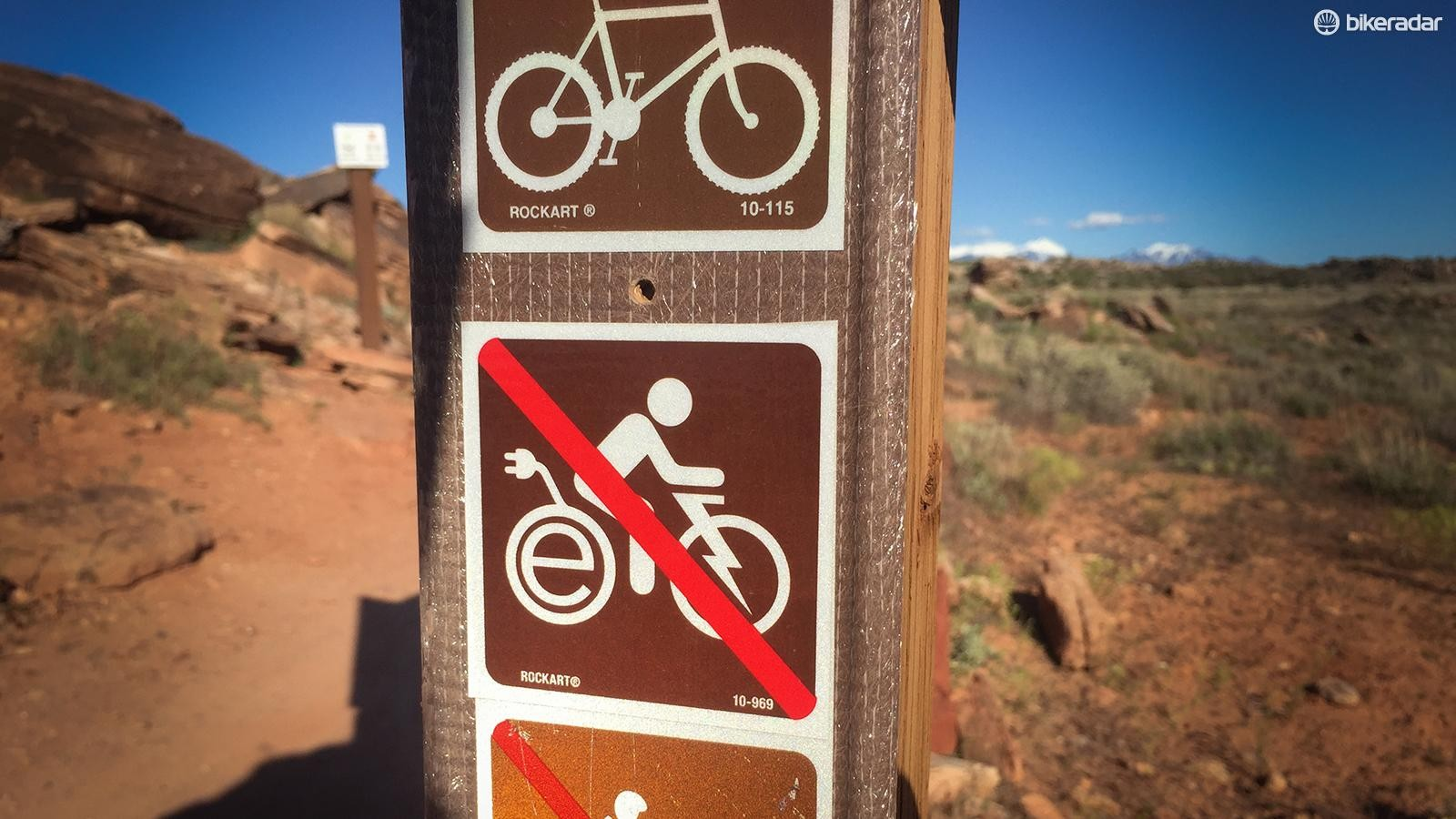 The companies pushing e-MTBs need to step up to educate retailers and riders as to where they are allowed and where they are banned — the future of trail access in the United States hangs in the balance