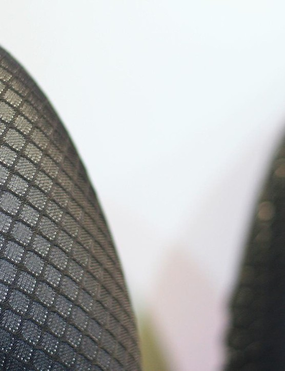 The disruption to airflow here is thanks to a textured woven material, rather than silicone print — used on the all-in-one road suit