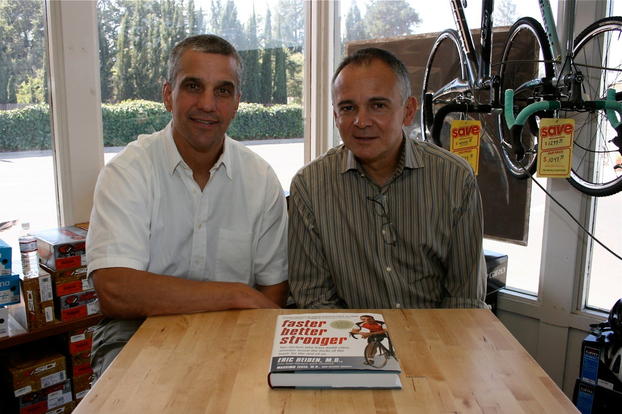 Sports doctors Eric Heiden (L) and Max Testa sign copies of their book at the Bicycle Outfitter in Los Altos, California September 13.