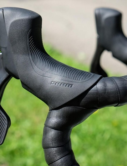 Road hydraulic levers pull back further than rim-brake levers, on both SRAM and Shimano models