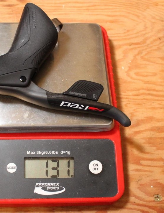 The eTap shifters are about 10g lighter than mechanical Red shifters. Claimed weight is 130g