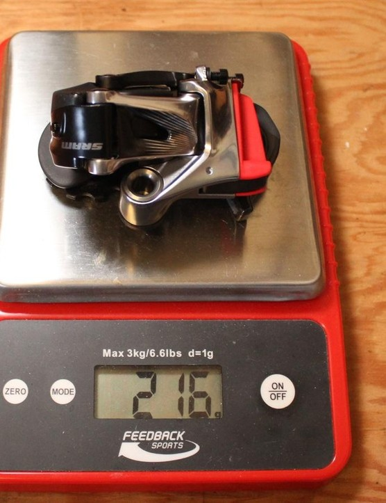 The eTap battery (not shown) weighs 24g, and the red plastic cover weighs 3g. So, total rear derailleur weight including battery is 237g, 2g less than the claimed weight