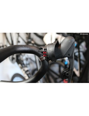 Each shifter has two ports shown here with red plugs. This is where the remote Blip shifters plug in