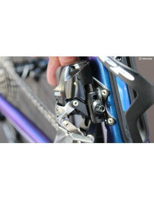 On the front derailleur, the function button moves the derailleur from one ring to the other. In initial setup, it also pairs the system