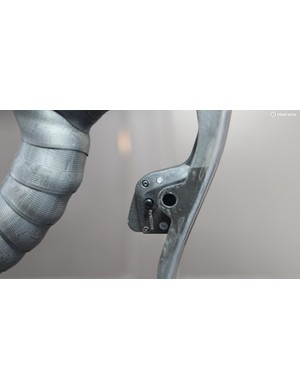 Holding the function button on the shifter and moving the lever micro-adjusts the rear derailleur. As with the shifting, the left lever micro-adjusts the derailleur inboard while the right lever moves it outboard