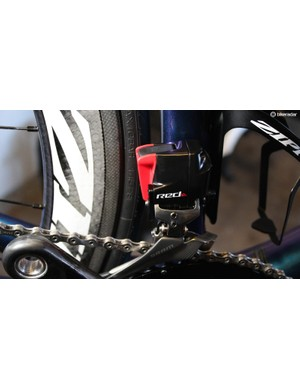 SRAM recommends detaching the batteries for travel and replacing with these red covers. When accelerometers sense movement, the system is kept awake; this applies to car or plane rides, too