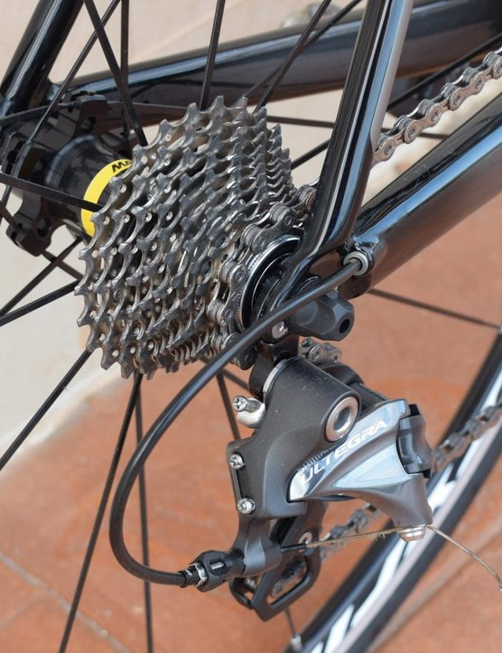 An 11-28 cassette takes care of most hills. Note the neat rear derailleur cable routing