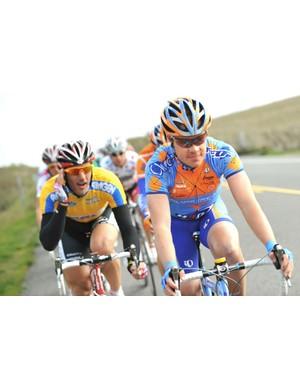 Tom Danielson (R), hoping some of Fabian Cancellara's yellow wears off.