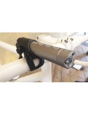 The 150 lumen FL150 light can rotate and switch to a four-LED front (or red rear) at the press of a button, with the adjustable mount secure holding the light barrel (which h)as a male USB fitting on its back end