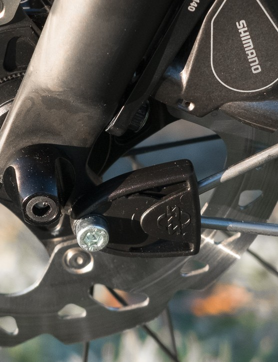 The fork has proper mudguard bosses at both the front and rear