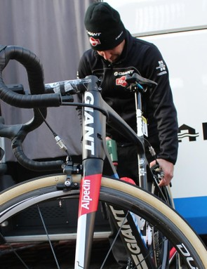 Team Giant-Alpecin mechanic Felipe Ennes Joudjakoff airs up Bert De Backer's 30mm tubulars with a Bosch electric hand pump to a specified pressure