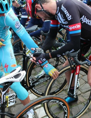 Air pressure is always a hot topic among mechanics and riders alike at Paris-Roubaix. ere, Astana's Gatis Smukulis checks out the cushioning on Roy Curvers' 30mm Vittoria setup