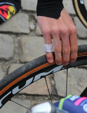 Mechanics use electric pumps and digital gauges; riders use their thumbs