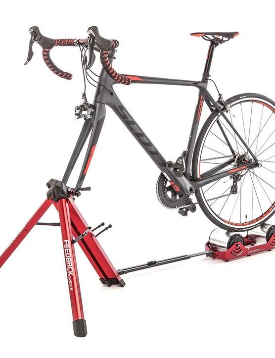 The bike attaches by the fork with a quick-release skewer