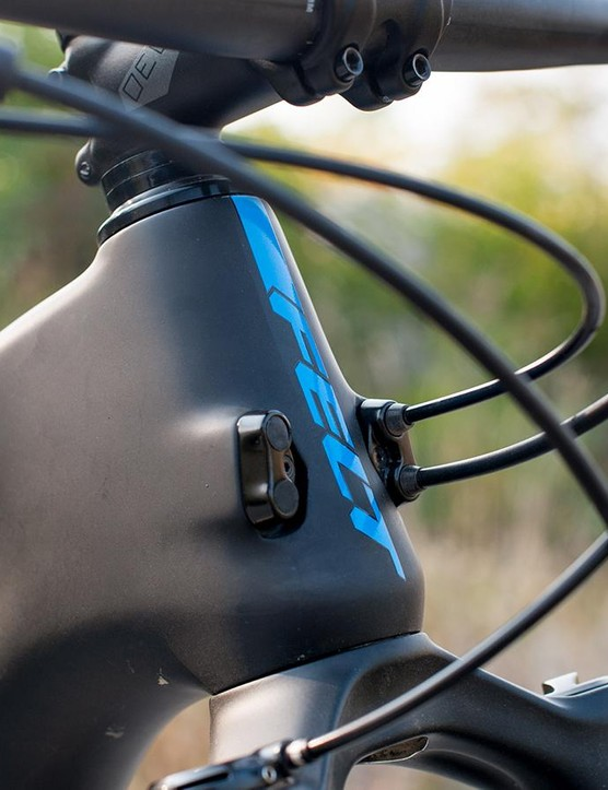 The internal cable routing plugs are ready to take internal dropper post and rear shock remote control lines, while front of face placement keeps paint unscuffed