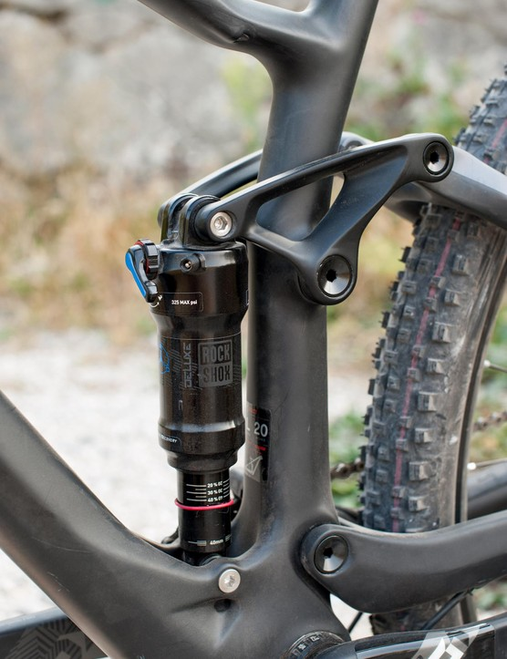 The Deluxe rear shock gets bearings in the upper mount for extra smoothness. The carbon rocker keeps weight down while the deep lower shock web allows continuous fibres to bridge from down tube to seat tube