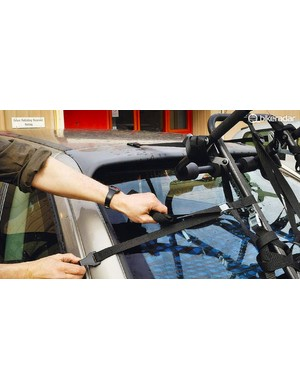 Each of these straps serve an important purpose — and don't forget the lateral ones, they'll keep your bike from flying off when going round corners