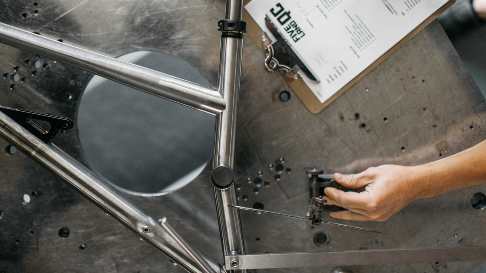 The steel front triangle is made by Five Land Bikes in the UK
