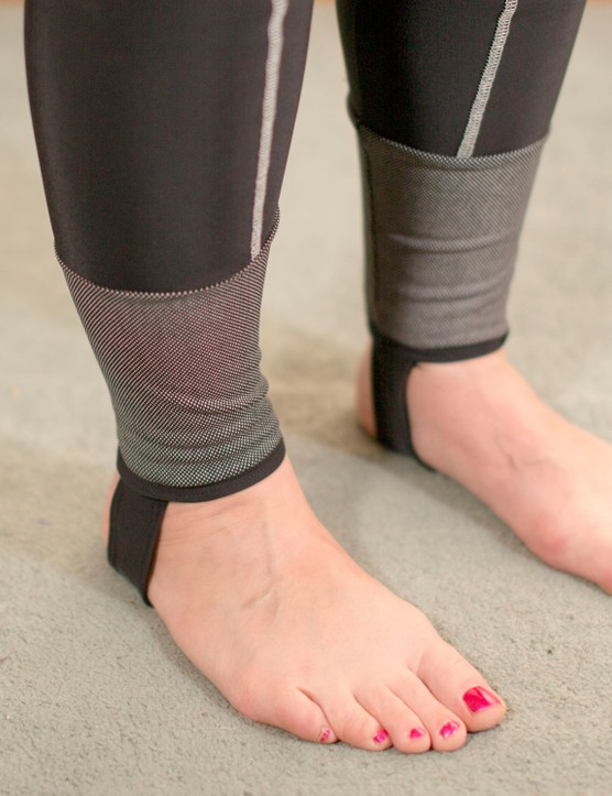 Stirrups keep the tights in place, with bright reflective sections around the ankles