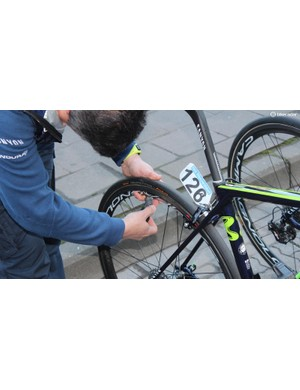 A Movistar mechanic dials in the specified pressure for each rider