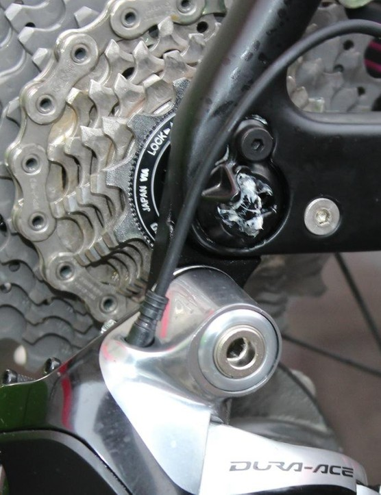 The RAT axles slide straight through, then lock in place with a 90-degree turn of the lever. Lampre-Merida mechanics greased the locking end of the RAT