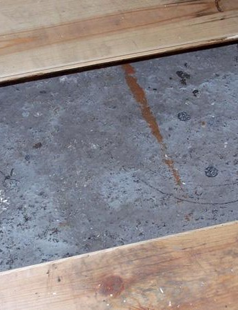 Cut a hole in the wood floor of the shed to allow access to the tougher concrete base underneath
