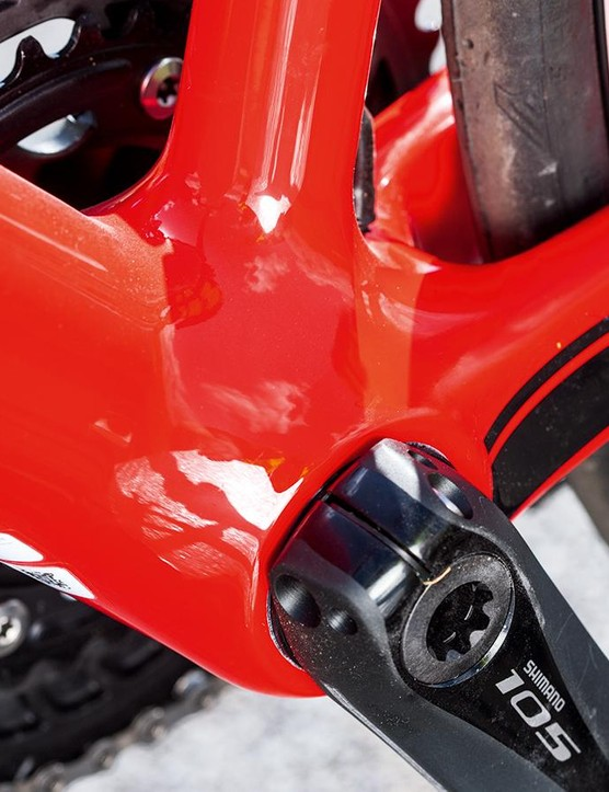 Chunky down-tube and bottom bracket area provide strength further along the frame