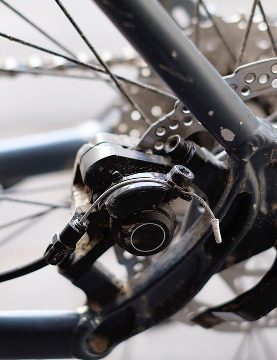 Cable-actuated Shimano disc brakes do a decent job of scrubbing off speed
