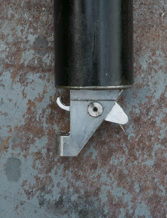 The internally routed post has this linkage to help reduce lever force